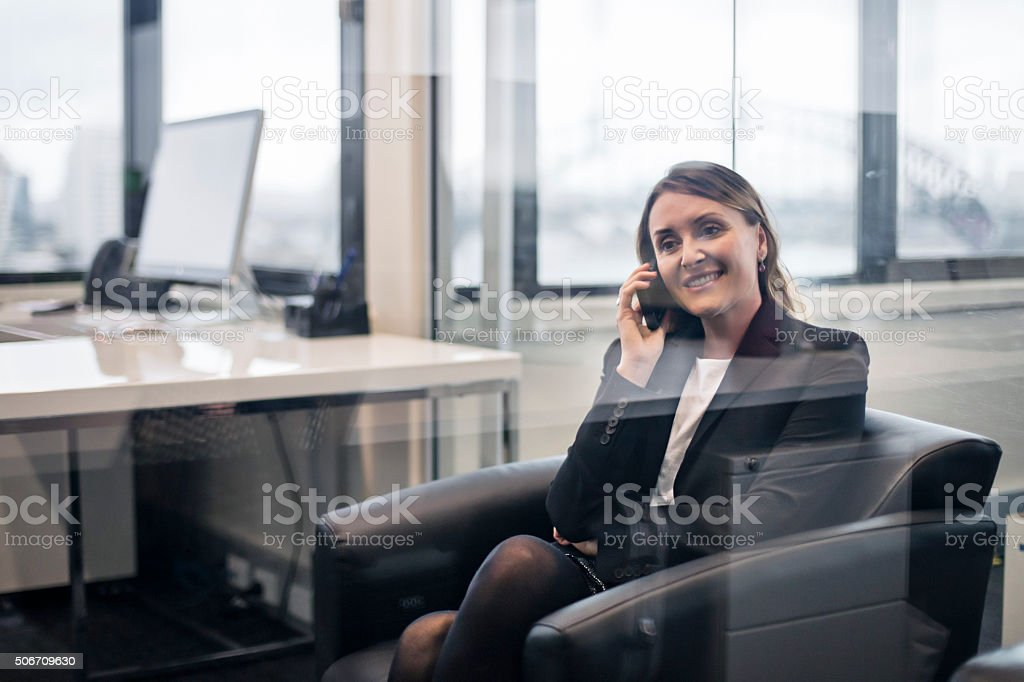 Mature businesswoman talking on her mobile phone stock photo