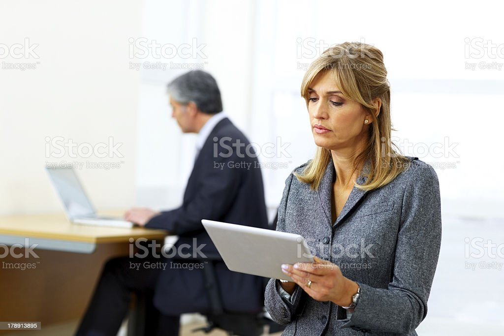 Mature businesswoman using digital table at home royalty-free stock photo