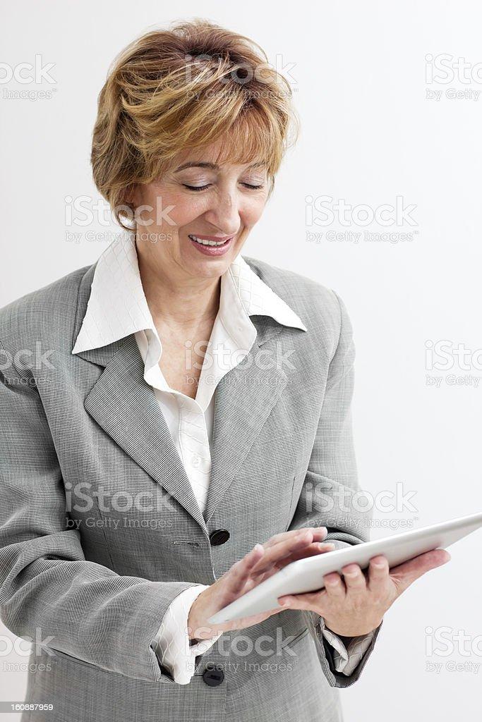 Mature  Businesswoman using Digital Tablet royalty-free stock photo
