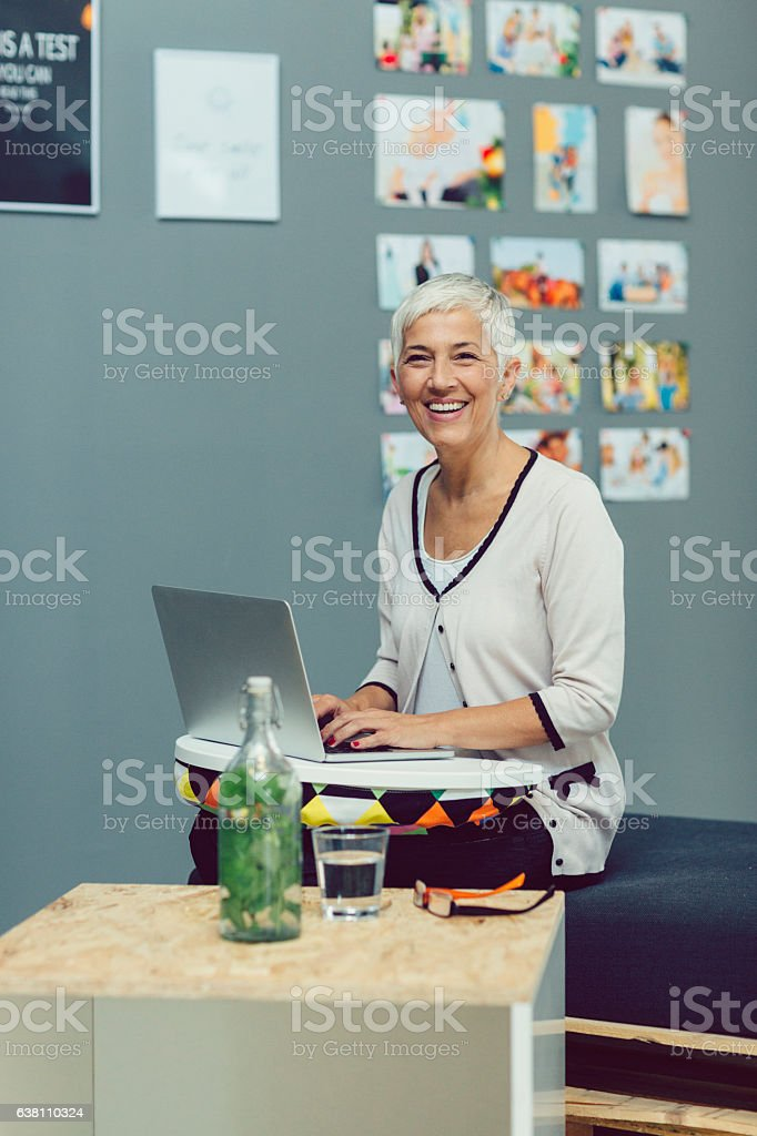 Mature Businesswoman Using Laptop stock photo