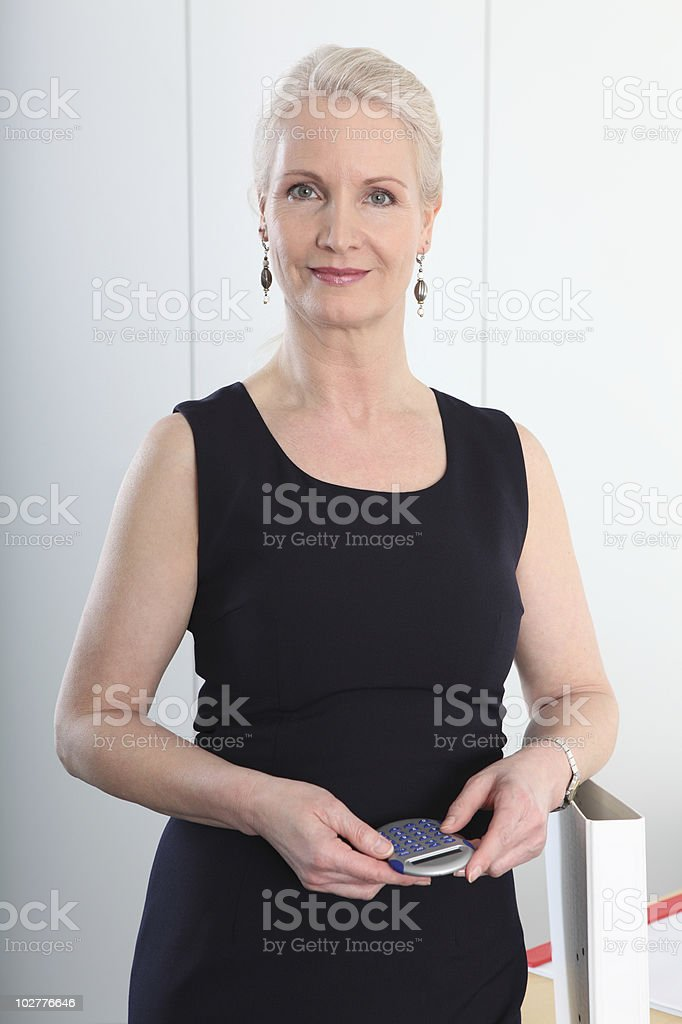 mature businesswoman with calculator royalty-free stock photo