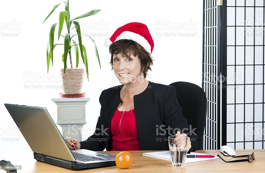 Mature businesswoman with hat royalty-free stock photo