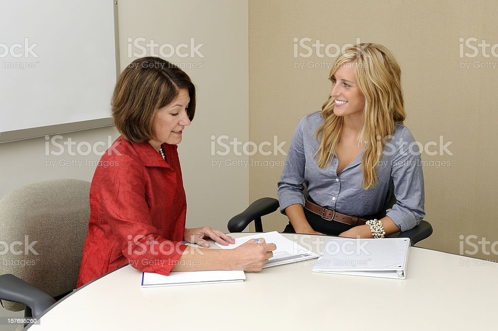 Mature Businesswoman with Smiling Young Colleague royalty-free stock photo