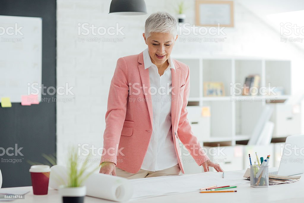 Mature Businesswoman Working In Her Office. stock photo