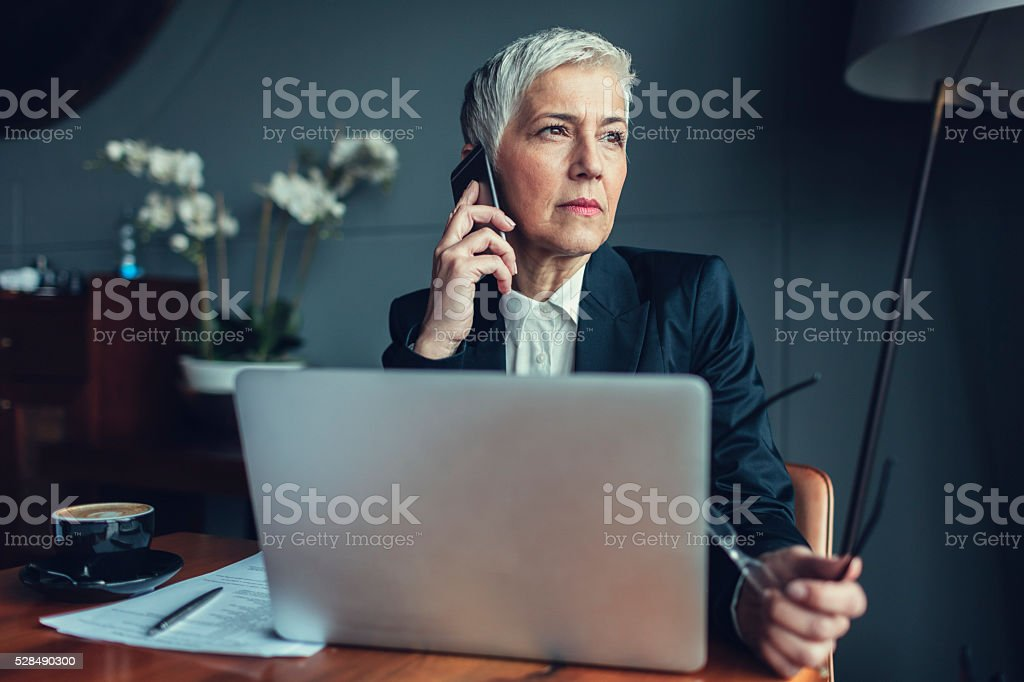 Mature businesswoman Working Out Of Office stock photo