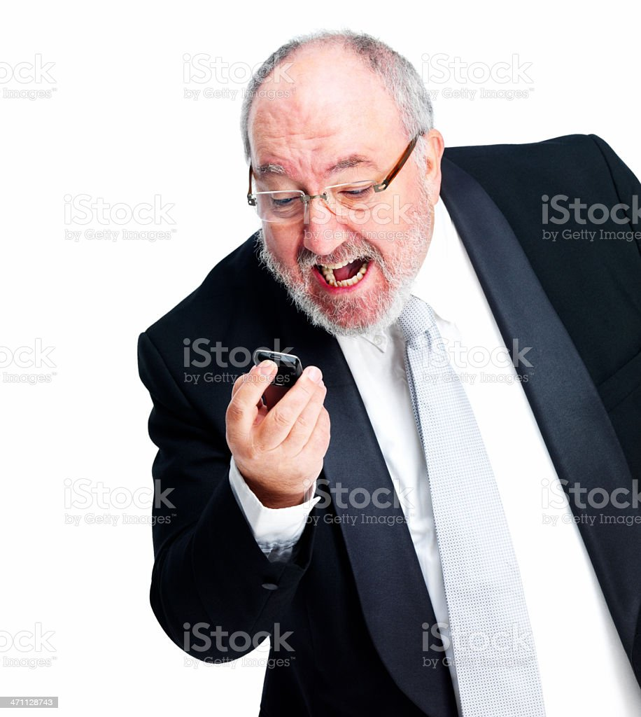 Mature bussinessman yelling at a cellphone royalty-free stock photo