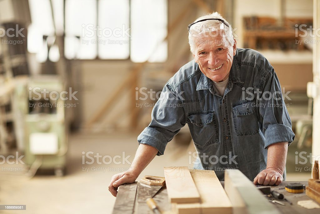 Mature carpenter at work stock photo