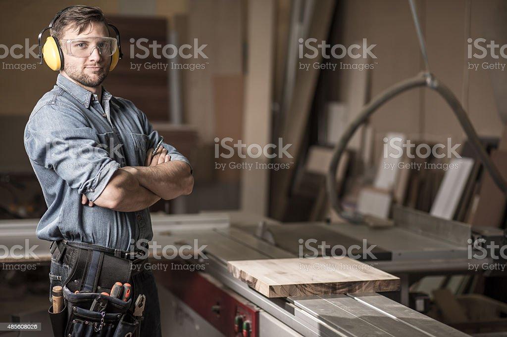 Mature carpenter in the workshop stock photo