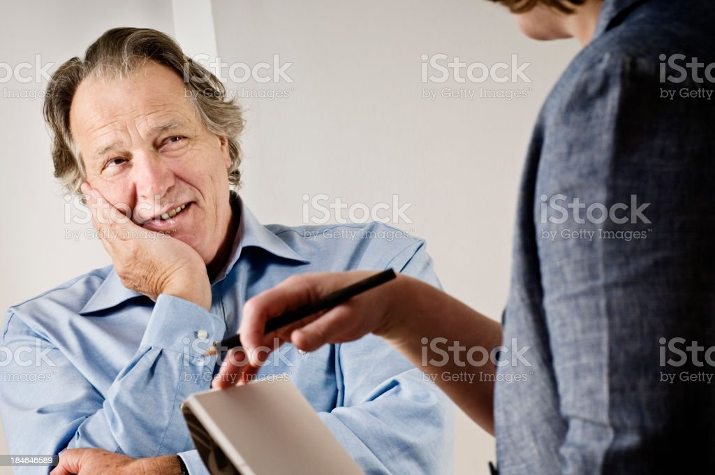 Mature Caucasian Male talking To a Counsellor royalty-free stock photo