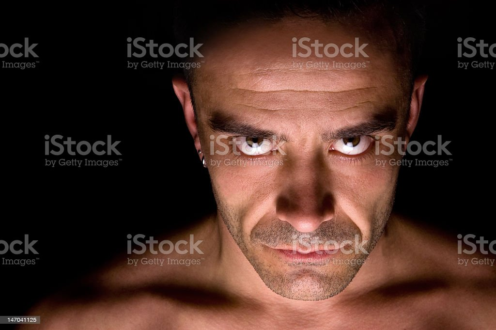 Mature Caucasian man with evil eyes stock photo