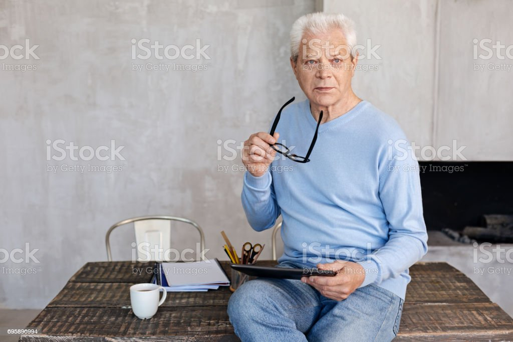 Mature classy man working in his home office stock photo