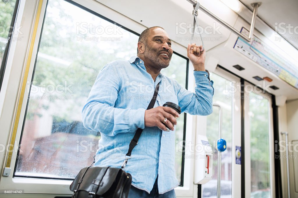 Mature Commuter Taking Public Transit stock photo