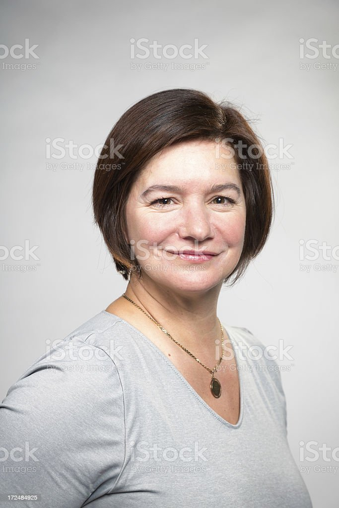 Mature Confident Caucasian woman portrait on Gray Vertical royalty-free stock photo