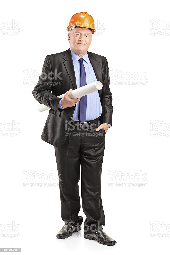 Mature construction worker with helmet holding blueprints royalty-free stock photo