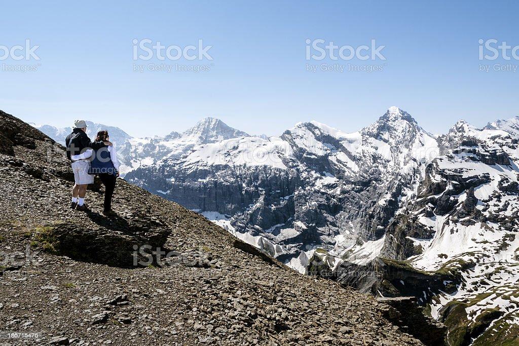 Mature couple admiring a snow covered mountain range stock photo