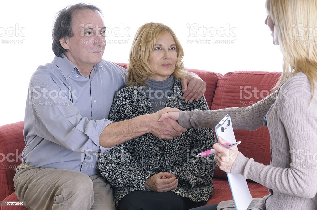 Mature Couple and Counselor Handshaking royalty-free stock photo