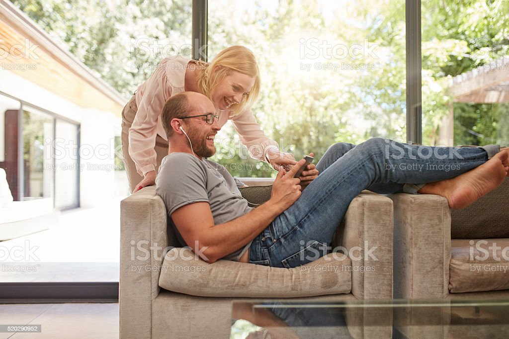 Mature couple at home using digital tablet stock photo