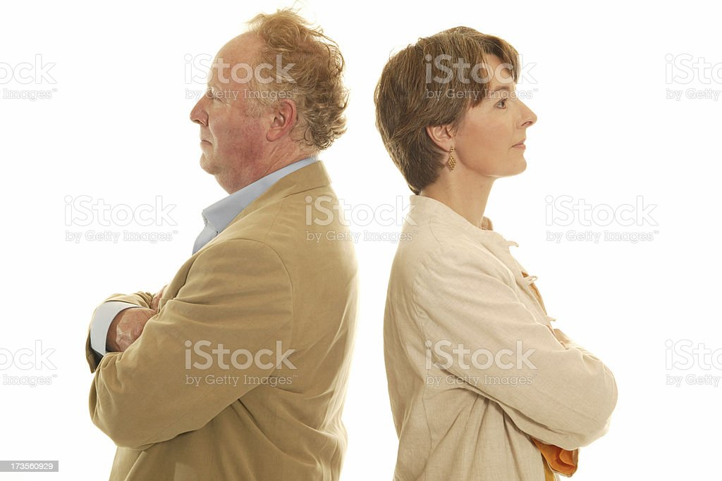 mature couple back to back royalty-free stock photo