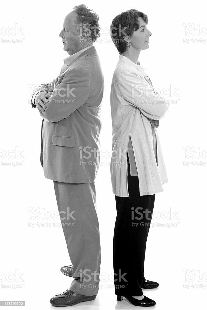 Mature couple back-to-back in b&w royalty-free stock photo