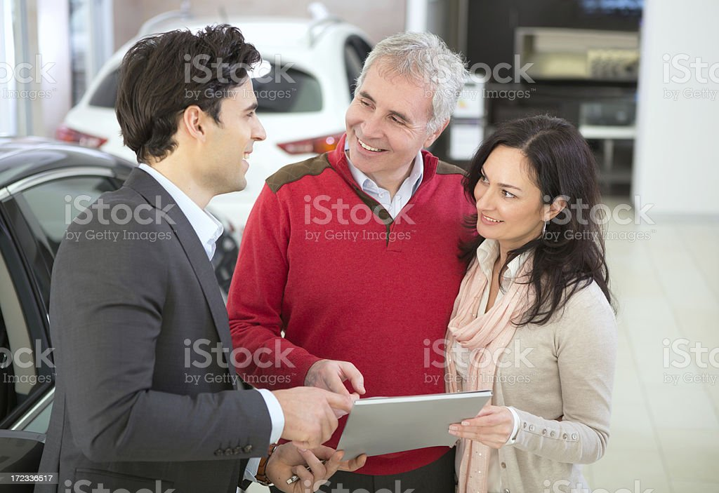 Mature couple buying car. royalty-free stock photo