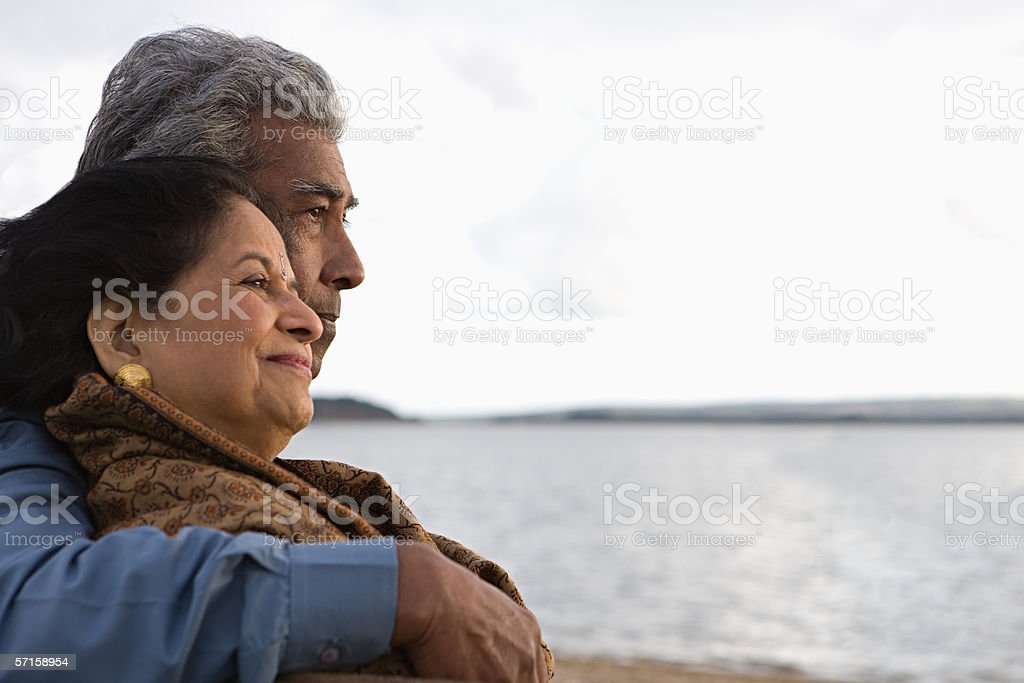 Mature couple by the sea stock photo