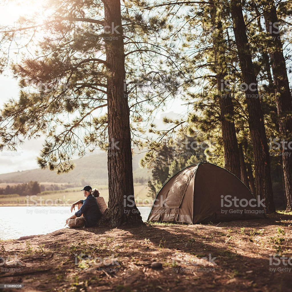 Mature couple camping in the woods stock photo