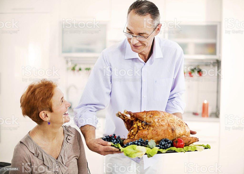 Mature couple celebrating Thanksgiving day royalty-free stock photo