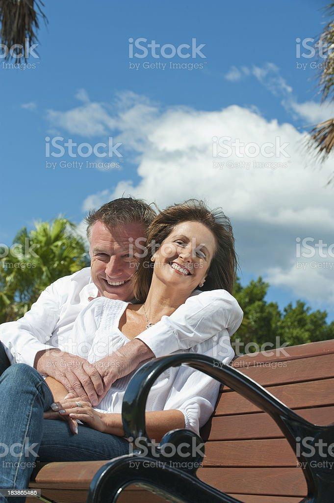 Mature couple cuddling royalty-free stock photo