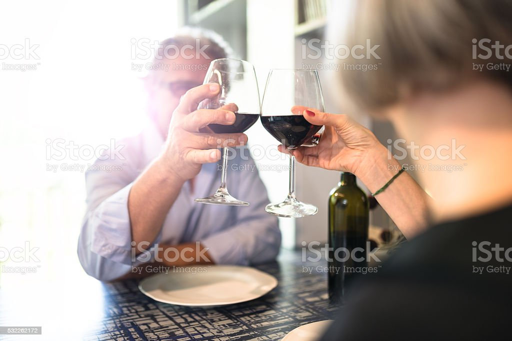 mature couple dinner at restaurant stock photo
