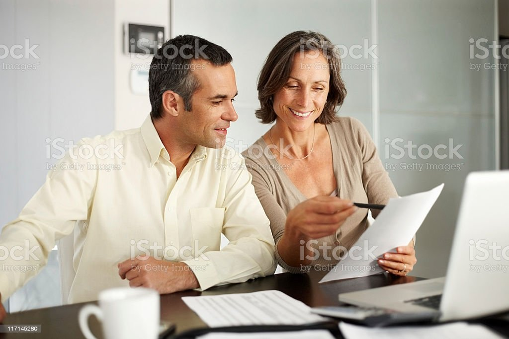 Mature couple discussing house budget royalty-free stock photo