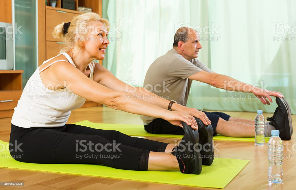 Mature couple doing exercises stock photo