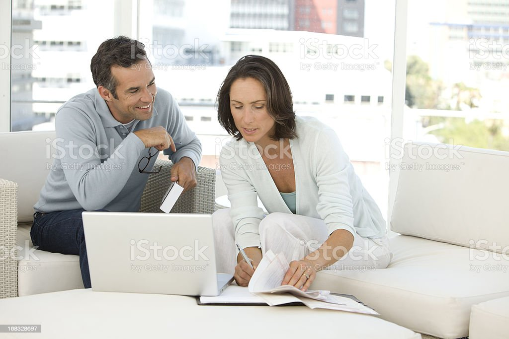 Mature couple doing home finances at home royalty-free stock photo