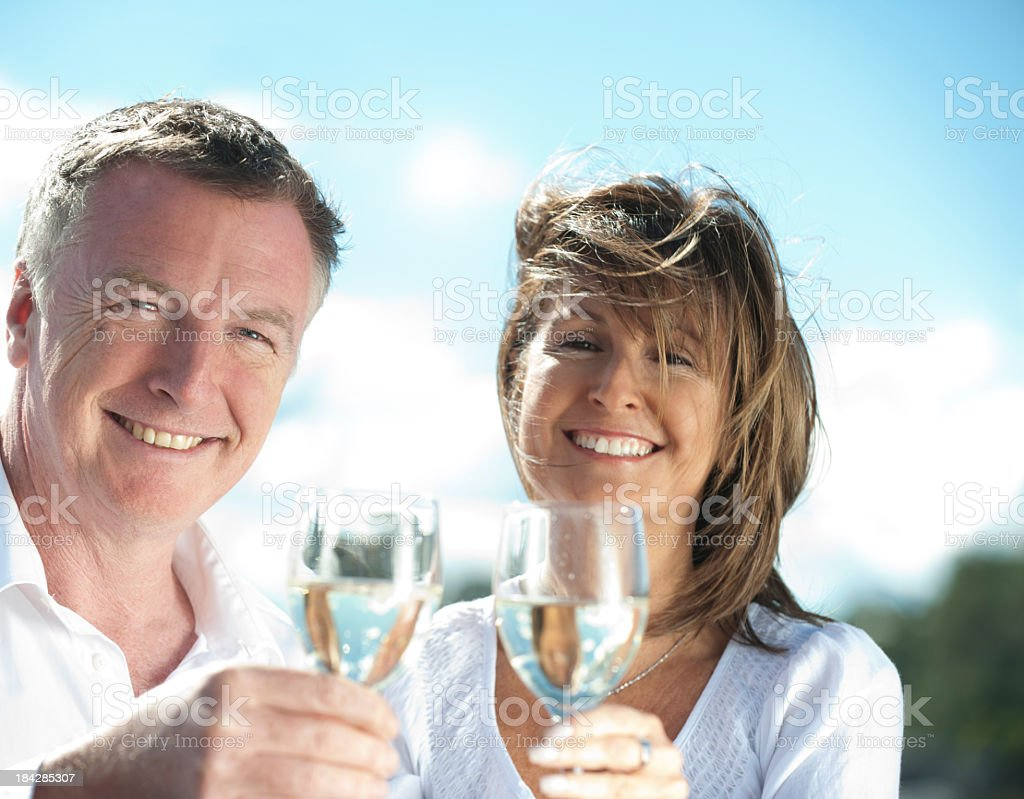 Mature couple drinking wine royalty-free stock photo