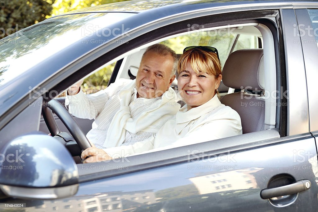Mature couple driving car royalty-free stock photo