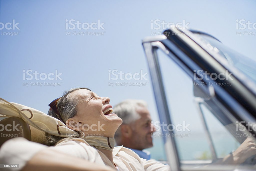 Mature couple driving in convertible royalty-free stock photo