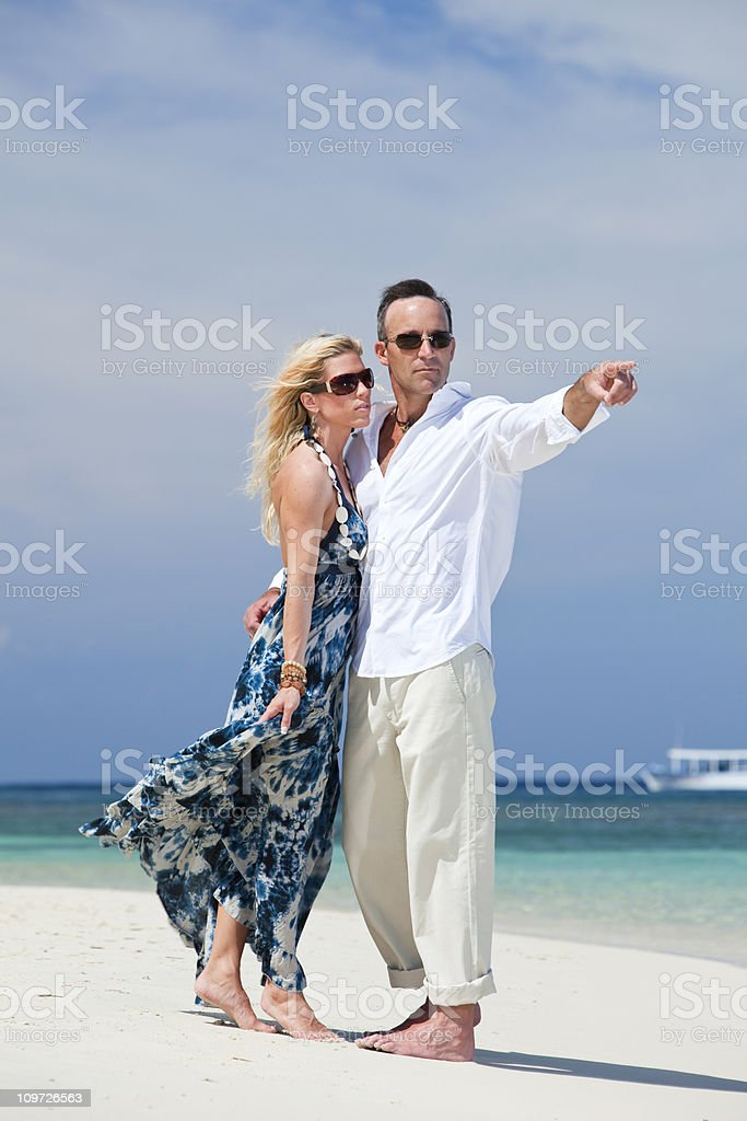 Mature couple embracing on beach royalty-free stock photo