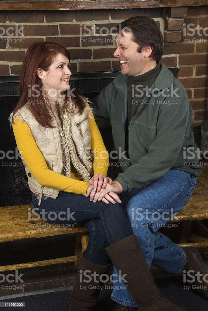 Mature couple enjoying a laugh together stock photo