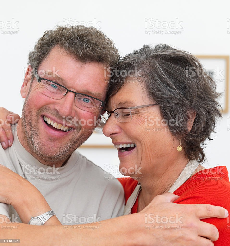 Mature couple enjoying a laugh together stock photo