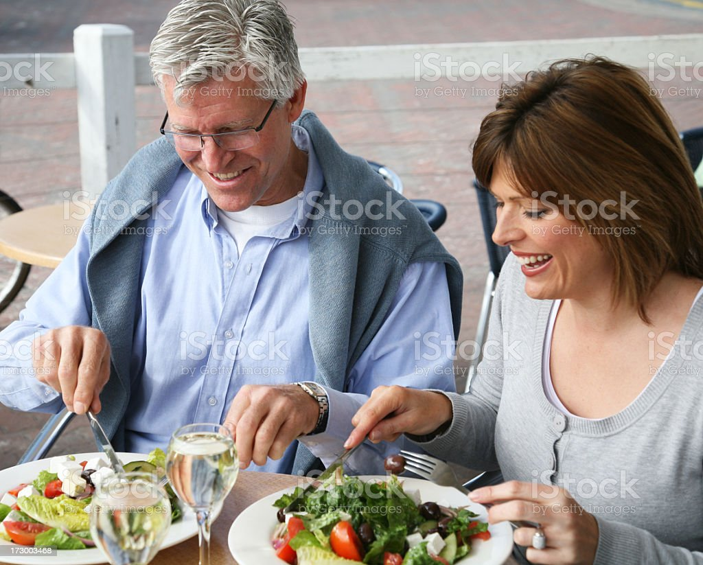 Mature couple enjoying a light lunch stock photo
