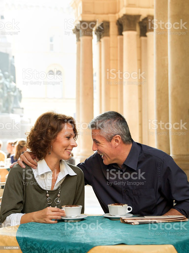 mature couple enjoying an cappuccino in cafe royalty-free stock photo