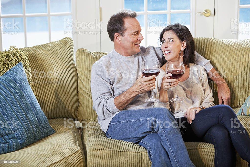 Mature couple enjoying glass of wine together stock photo