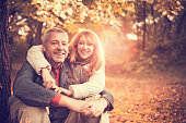 Mature couple enjoying in autumn day.