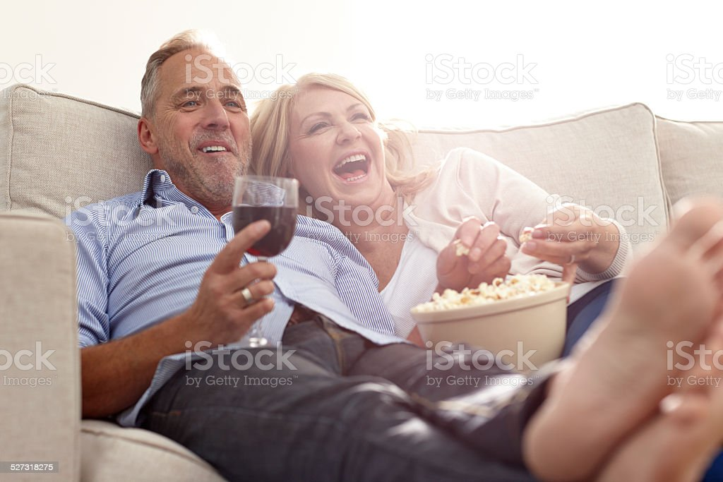 Mature couple enjoying watching movie stock photo