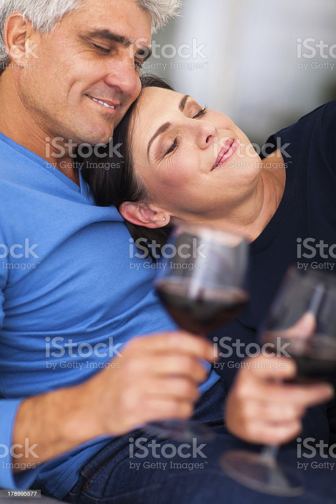 mature couple enjoying wine at home royalty-free stock photo