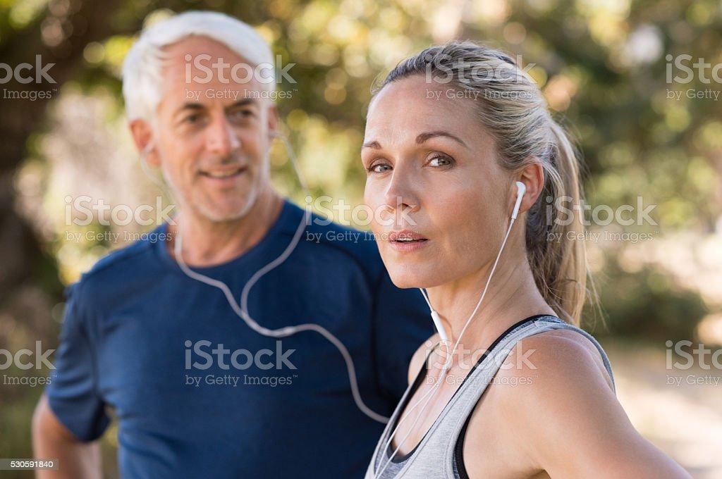 Mature couple exercising stock photo