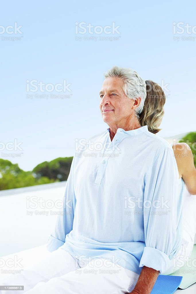 Mature couple exercising using back as their support royalty-free stock photo
