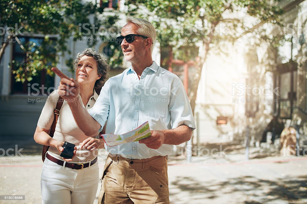 Mature couple exploring a foreign city stock photo