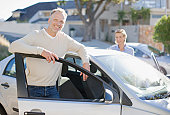 Mature couple getting into car