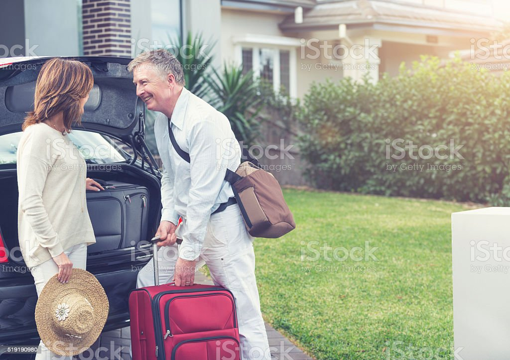 Mature couple going on a trip. stock photo