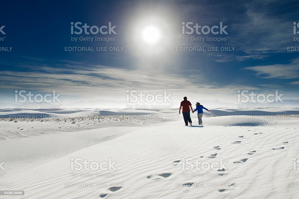 Mature couple hand in hand at White Sands dunes royalty-free stock photo